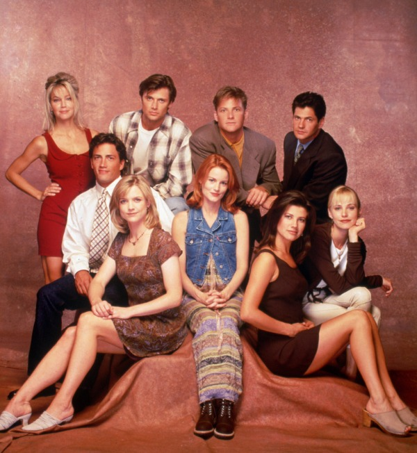 "This 1995 photo shows the cast of ""Melrose Place"", from top left; Heather Locklear, Grant Show, Doug Savant and Thomas Calabro. Seated from left; Andrew Shue, Courtney Thorne-Smith, Laura Leighton, Daphne Zuniga and Josie Bissett. (AP Photo)"